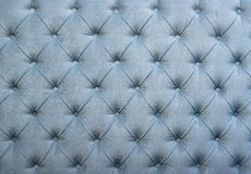 Blue capitone tufted fabric upholstery texture Royalty Free Stock Photography