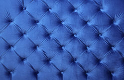Blue capitone tufted fabric upholstery texture Royalty Free Stock Photos