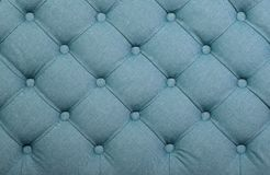 Blue capitone tufted fabric upholstery texture Royalty Free Stock Images
