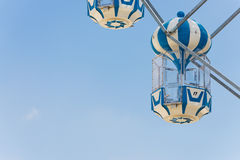 Blue capsule seat of carousel in amusement park Stock Images