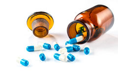 Blue capsules with  bottle, healthcare and medicine Royalty Free Stock Photography