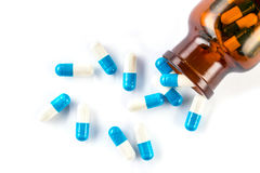 Blue capsules with  bottle, healthcare and medicine Stock Photos