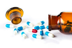 Blue capsules and red capsules with  bottle, healthcare and medi Stock Photography