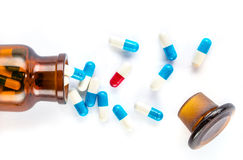 Blue capsules and red capsules with  bottle, healthcare and medi Stock Photo