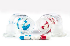 Blue capsules and red capsules with Transparent  bottle Stock Image