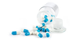 Blue capsules with Transparent  bottle, healthcare and medicine Stock Image