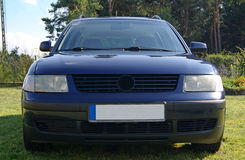 Blue Car. Car standing parked in the grass Royalty Free Stock Images