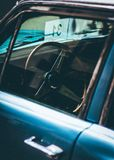 Blue Car With Black and Gray Steering Wheel stock photos
