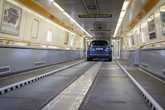 Blue car on board of Eurotunnel train connecting the UK and Fran royalty free stock photo