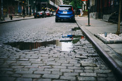 Blue Car on Brick Road during Daytime Royalty Free Stock Images