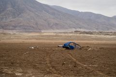 Blue car buried under the earth after a flood in Chañaral, Chile. Natural disasters royalty free stock images