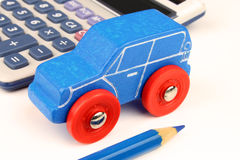 Blue Car & Calculator Royalty Free Stock Photography