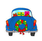 Blue car with Christmas wreath Royalty Free Stock Photography