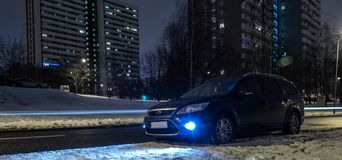 Blue Car in city at night Royalty Free Stock Photo