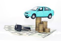 A blue car with coins. Money black keys and dollars isolated on white background Stock Photography