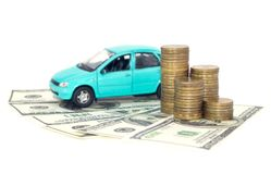 A blue car with coins. Money and dollars isolated on white background Stock Image