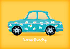 Blue car with daisies Stock Image