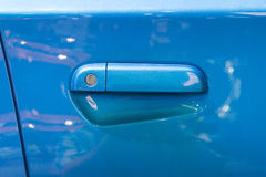 Blue car door lock and handle Royalty Free Stock Photo