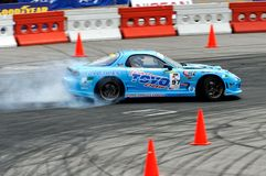 Blue car drifting at a competition Royalty Free Stock Photography