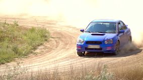 Blue car drives an extreme turn. Slow motion stock video footage