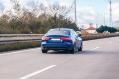 Blue car drives on a german motorway. A blue car drives on a german motorway stock image