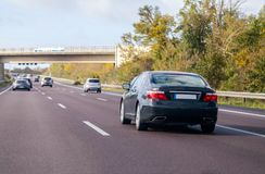 Blue car drives on a german motorway. A blue car drives on a german motorway royalty free stock photography