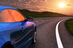 Blue car driving by autobahn in sunset Royalty Free Stock Photo