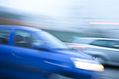 Blue car driving fast on country road Royalty Free Stock Photos