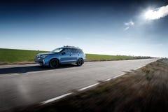 Blue car fast drive on asphalt road at daytime stock photos