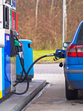 Blue car at gas station Royalty Free Stock Image