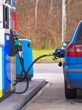 Blue car at gas station