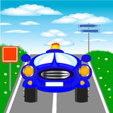 Blue car goes on road Royalty Free Stock Image