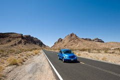 Blue Car on highway Royalty Free Stock Images