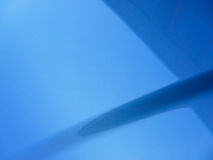 Blue car hood. Abstract close up of a blue automobile hood Royalty Free Stock Image