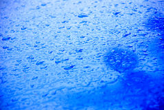 Blue car hood in the rain Royalty Free Stock Photography