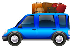Blue car loaded with luggages Stock Images