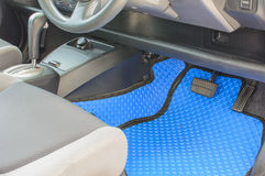Blue car mats. Blue rubber car mats in car Stock Photo