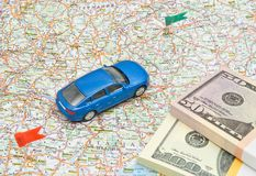 Blue car and money on map Stock Photo