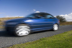 Blue car on the mountain road Royalty Free Stock Image