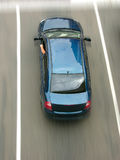 Blue car seen from above moving at speed Stock Photography