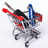 Blue car in shopping trolley Stock Photo
