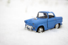 Blue car in snow Royalty Free Stock Photography
