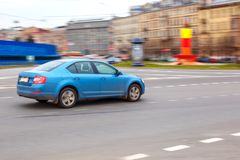 Blue car at speed in the city royalty free stock photo