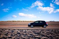 Blue car standing on road Royalty Free Stock Photography
