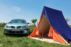 Blue car with tent holiday Royalty Free Stock Images