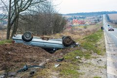 The car got into an accident on the highway Lviv-Ivano-Frankivsk (Ukraine), on May 2, 2018. The blue car turned over in a ditch n royalty free stock photos