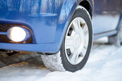 Blue Car with Winter Tires on the Snowy Road. Drive Safe. Royalty Free Stock Image