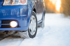 Blue Car with Winter Tires on the Snowy Road. Drive Safe. Stock Photography