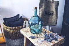 Blue carafe on the stool Stock Images