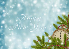 Blue card for the holiday with branches. And clock Stock Image